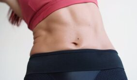 Muscular Belly Slender Woman Wet with Sweat After Workout Slimming and Slim Body