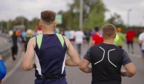 Fit Men Running Marathon in City