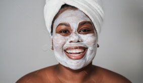 Young african girl wearing beauty skin mask treatment – Focus on face